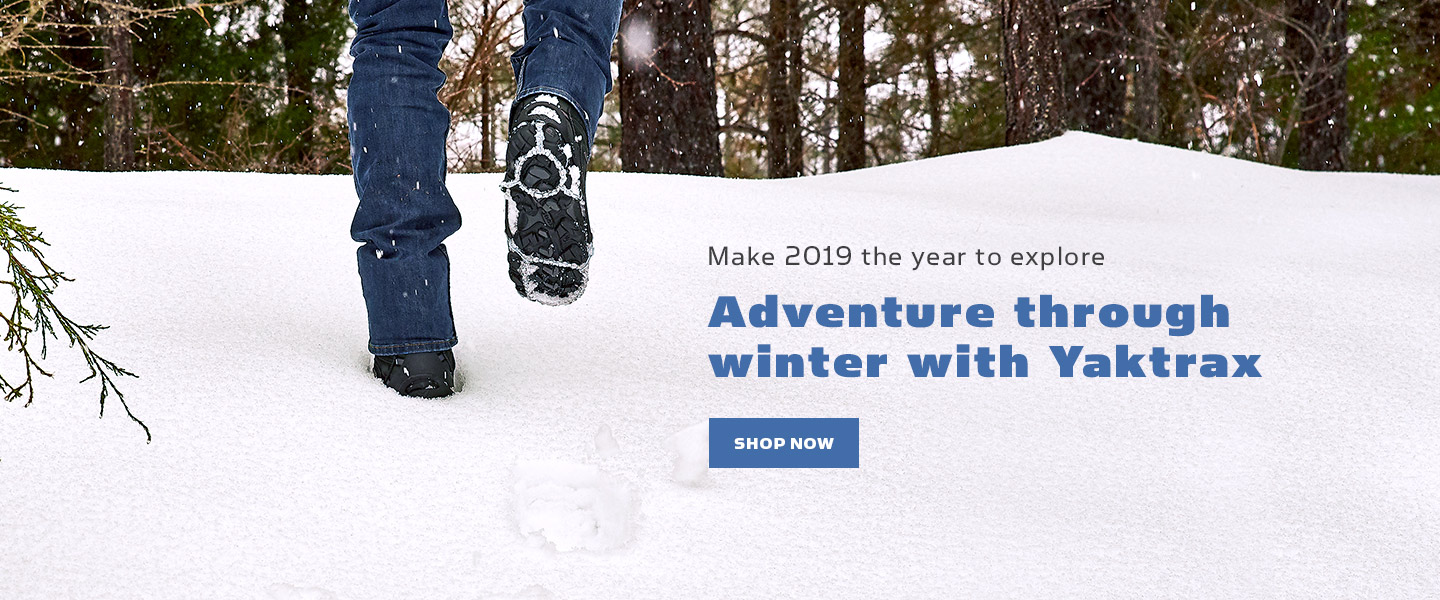 "Men's feet walking up a snowy hill in Yaktrax Walk next to text that reads ""Adventure through winter with Yaktrax""."